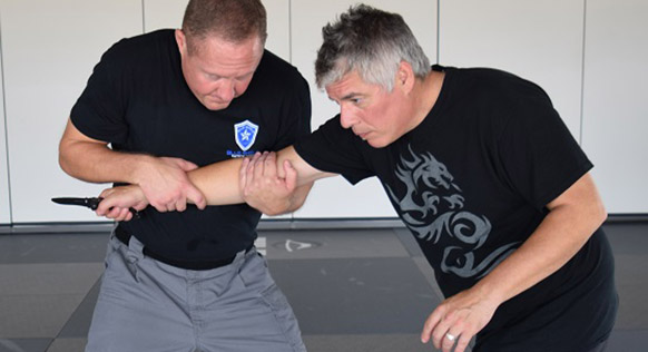 Knife Defense Instruction