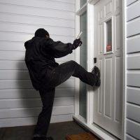 Burglar kicking door